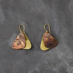 "Drawn from the shape of fluttering wings, these drop earrings are formed from oxidized brass. Inspired by organic design and traditional Latin American crafts, each Sibilia piece is made by hand in the Abasto district of Buenos Aires, Argentina.- Oxidized brass, gold plated hypoallergenic ear wire- Avoid contact with water and chemical agents/cleaners- To preserve finish, do not clean with polishing cloth- Handmade in Argentina1""W, 1.5""L"