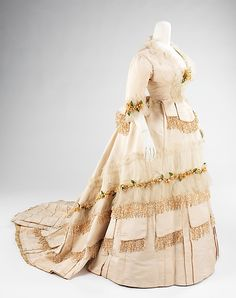 Wedding Dress.  Date: 1874. Culture: American. Medium: silk, wax. Dimensions: Length at CB (a): 27 in. (68.6 cm). Length at CB (b): 73 in. (185.4 cm).