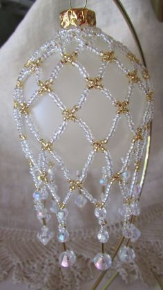 Lovely Victorian hand beaded ornament cover. White AB beads with gold accent beads. Crystals and gold bugle beads complete this ornament cover.