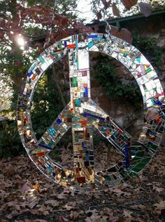 Peace sign made out of mirror tiles art