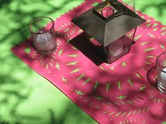 Tin lanterns with Mexican paper and bright table cloth below