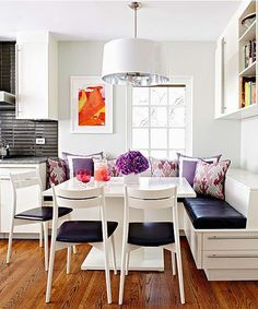 Love this booth style table for an eat-in kitchen! And it has storage built in too :)