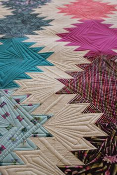 Exemplary quilting by Angela Walters, Peaks and Valleys quilt by Tula Pink, October 2013