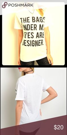"""Black and white tee Graphic top features a relaxed fit and """"the bags under my eyes are designer"""" saying on center front. 85% polyester 15% cotton. All reasonable offers accepted! 😜 Tops Tees - Short Sleeve"""