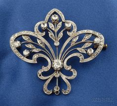 Edwardian Diamond Brooch, set with old mine and rose-cut diamonds, platinum-topped gold mount, lg. 1 3/4 in.