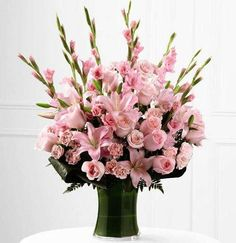 Send a personalized bouquet of fresh flowers to express your condolences. Decorations, standing sprays, casket adornments, wreaths, and more. Gladiolus Bouquet, Gladiolus Arrangements, Vase Arrangements, Light Pink Flowers, Fresh Flowers, Pink Roses, Pale Pink, Memorial Flowers, Funeral Arrangements