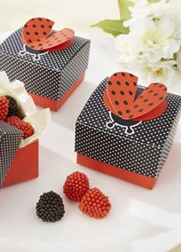 "Everyone delights at seeing a ladybug land on a shoulder or make its way across a leaf. Ladybugs are just so...cute! Treat the guests at your bridal shower to the thrill of a ladybug landing close by--and this one's more than cute--its carrying candy! Features and Facts:   Dimensional red-and-black ladybug tops and black-with-white-polka-dots favor box with a red base.  Favor box measures approximately 2"" h (including 3-D wings) x 2 1/4"" w x 2 1/4"" in d.  Sold in sets of 24.  Some ..."
