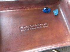 No matter how hard the past, you can always begin again. Leather tray detail.