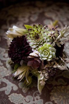 Offbeat succulent and purple fall wedding bouquet | http://www.weddingpartyapp.com/blog/2014/09/18/fresh-fall-wedding-bouquets-romantic-bride/