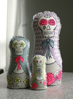 Two of my favorite things: Dia de Muertos and Matryoshka. I would give anything for these!