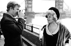 """Michael Caine and Shelley Winters in the photography scene of the movie """"Alfie"""", 1966."""