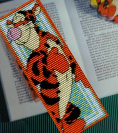Made by Marian. Bookmark Teigetje embroidered on plastic canvas. A 'Royal Paris' cross stitch Bookmark kit.