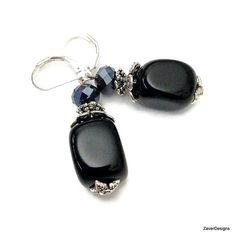 Beautiful black onyx dangle earrings made with a large chunky black onyx nugget bead and sparkling faceted black crystal. Silver bead caps highlight the richness of the gemstone. The earrings hang on silver ear wires. Measurement:Approx Length:1.75(see 3rd photo) Black Onyx Nugget:12mm x16mm Black crystal:6mm Silver Bead caps:6-9mm  For more black onyx jewelry, click the below link to view https://www.etsy.com/listing/247444904