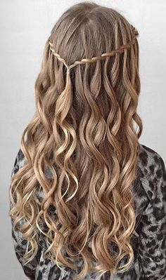 Twisted waterfall half-updo with curls