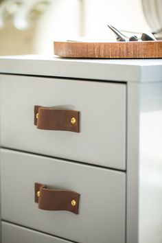 """This IKEA hack is their proudest DIY: """"...we replaced the drawer handles with strips of saddle leather and gold hardware — it took that furniture piece to another level!"""""""