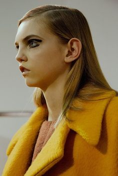 Molly Bair in graphic eyeliner and yellow teddy bear coat at Rochas AW15 PFW. See more here: http://www.dazeddigital.com/fashion/article/23963/1/rochas-aw15