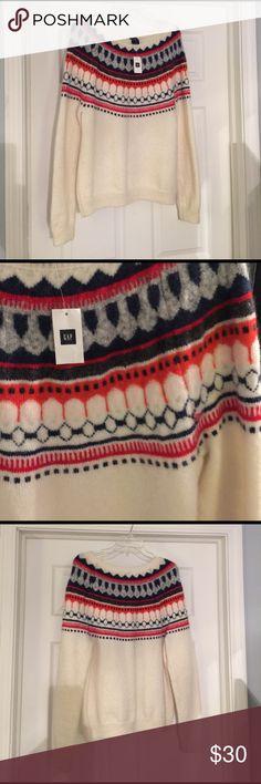Fair Isle Gap sweater NWT. Ivory, blues and orange multi colored fair isle sweater. Comfy fit. Never worn. GAP Sweaters