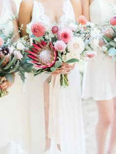 Pink protea and dahlia blooms took this boho chic wedding held at the San Diego Botanic Garden to the next level of pretty.