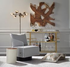 """TREMONT WALL SCULPTURE Go organic with a natural shape of sustainably harvested teak root to highlight a wall and add warmth to a room. Each piece is unique, measuring approximately 40""""w x 40""""h.  $378 on fireplace wall?"""