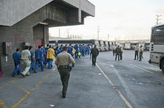 Loading Buses with Inmates to Go to Court. (Photo Credit: C. Miller)