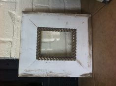 Distressed handmade picture frame.