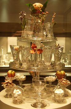 A pyramid of salvers or 'waiters' with a range of Georgian sweetmeat glasses, including rare flower glasses. The pyramid is surmounted by a 'top glass' containing a carved orange.