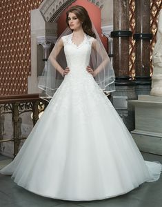 Justin Alexander wedding dresses style 8720 Alencon and Venice lace tulle ball gown features a Queen Anne neckline  and basque waistline. Gown is finished with satin buttons that enclose  the high lace illusion back and cover the zipper. Style features a  chapel length train.