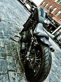 The custom Harley Davidson Iron 883 sportster bobber