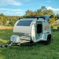 """Solar panels, propane tank, bike rack, cook area, sleeping area, and all in a compact, rugged little travel trailer teardrop unit. This one is by Inka Outdoor, and it's called the Venture OHV Off-Road... Rough Ridge Edition. """"Rough Ridge Edition is a fresh take on the overland adventure camper. A rugged yet fairly lightweight approach…"""