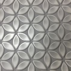 This Geometric Petals Wallpaper has a pattern of petal shapes with a metallic silver finish on a matte grey background that uses shading for a effect Silver Textured Wallpaper, Geometric Wallpaper, Pattern Wallpaper, 3d Wall Panels, Design System, Loft Design, High Quality Wallpapers, Gray Background, Geometric Designs