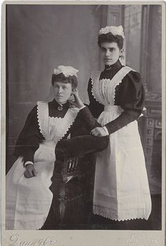 Dowstairs Elegance - An English Cabinet Card of two maids in their crisply starched white aprons who must have worked in an elegant house or fine hotel.  (circa 1900-1914)