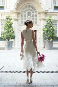 So beautiful.....love the shoes and uniqueness of the dress!