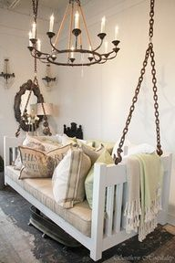 Repurposed crib into porch chair. Great idea for upcycled crib.
