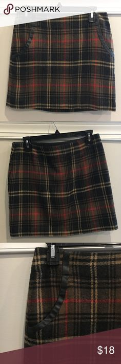 Adorable Plaid Skirt Sz.4 Super cute plaid mini skirt with leather faux pocket detail, size 4. From The Limited, in excellent condition! The Limited Skirts Mini