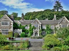 """The ancestral home of Reverend Sabine Baring-Gould (best known for writing the hymn """"Onward, Christian Soldiers""""), Lewtrenchard Manor is  filled with light from leaded windows that look out onto the gardens, and with unique features like a gilded leather frieze in the front room."""