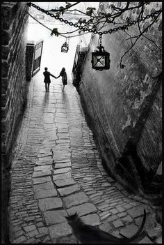 engagement proposals, wedding honeymoon photography ideas, black white photo, couple holding hands waling down long stone village street, lantern overhead. Fan Ho, Street Photography, Art Photography, Wedding Photography, Beautiful Places, Beautiful Pictures, Monochrom, Black And White Pictures, Belle Photo