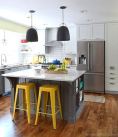 Cool White Finish Amish Kitchen Cabinets In Modern L-Shaped Kitchen Decorating Idea Features Yellow Bar Stools And Unique Black Island Pendant Lamps Also White Subway Tiles Backsplash Plus Light Green Wall Painting As Well As Amish Cabinetry And Outdoor Kitchen Cabinets, Stunning Custom Amish Kitchen Cabinets Design Inspiration And Ideas: Kitchen