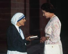 The Queen presents Mother Teresa of Calcutta with the Insignia of the Honorary Order of Meric in New Delhi on Nov. 24, 1983.