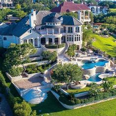 This lakefront stone mansion is located at 213 Costa Bella Drive in Austin, TX and is situated on acres of land. Stone Mansion, Dream Mansion, Big Mansions, Mansions Homes, Dream Home Design, My Dream Home, Luxury Homes Dream Houses, Modern Pools, Modern Mansion