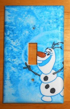 Olaf From Frozen Light Switch Plate Cover  (Matching Electrical Outlet Cover also available)  Handcrafted. No two are alike.  Positioning of Pattern may vary.  Easy to clean with a damp cloth.  Mounting screws included  If you need a different size or kind, please contact me and I can put a custom order together for you