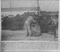 Oct. 18, 1951 - Earth-moving equipment is built by two Drott Manufacturing Company employees in Schofield.