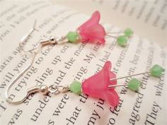 Pink and Mint Green Fairy Trumpet Flower Whimsical Wedding Earrings   These Gorgeous Trumpet Flower Dangle Earrings are made in my Shop by me.   When you order Jewelry from Our Twisted Creations you can rest assured that you will receive Quality Handmade Jewelry that will last you for years to come!   ~~~~~~~~~~~~~~~~~~~~~   These Beauties are made using Pink Acrylic Trumpet Flower Beads, 6mm Mint Green Swarovski Crystals, and Silver Earring Hooks.   The Pink and Mint Green colors that are…