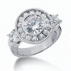 3 stone round halo engagement ring with antique hand engraving available at Wheat Jewelers