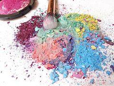 Professional make-up brush on mixed colorful crushed eyeshadow
