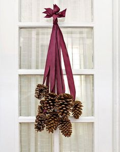 Hangingpine cones and ribbons .... haha I made this and my husband said it looks like dingle-berries.... Maybe i'll try it again this year lol