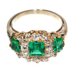 Late Victorian English Triple Cluster Diamond and Emerald Ring | From a unique collection of vintage three-stone rings at https://www.1stdibs.com/jewelry/rings/three-stone-rings/