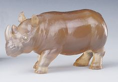 A small rhinoceros carved in chalcedony with rose diamond eyes.  One of three rhinoceroses by Fabergé in the Royal Collection.