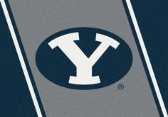BYU Brigham Young Spirit Mascot Rug. This Milliken Cougars rug features the mascot boldly on display upfront and center. These rugs are made to order in the U.S.A and are made of 100% Nylon Pile Fiber