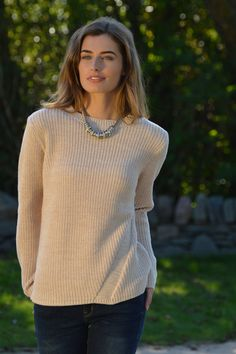 Happy Kinda Life - Stylish relaxed fit, cotton blend round neck jumper that goes from day to night. Notice the diagonal rib design for added dimension. and the hi low hem for added style points. Pair yours with slick leather or denim for a cool play on texture.