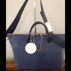 """Authentic CHLOE' Leather """"Baylee"""" Convertible Bag Authentic Chloe Baylee Bag - NWT - RV $2050  Color:Blue / Navy - two shades of blue Smooth leather with goldtone hardware Decorative chainlink at front Dual zip closure Detachable, adjustable wide strap ~ 40"""" with 16"""" drop; there are some scuff marks on the metal buckle of the strap due to packaging - barely visible - price reflects this Double top handles Lined interior with two pockets Made in Italy  Comes with dust bag and…"""
